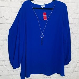 Avenue blue blouse with puff sleeve and necklace